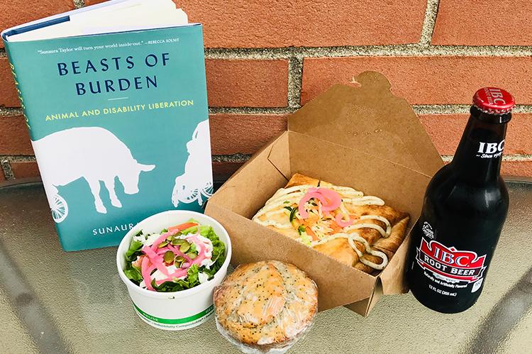 Beasts of Burden book next to vegan food